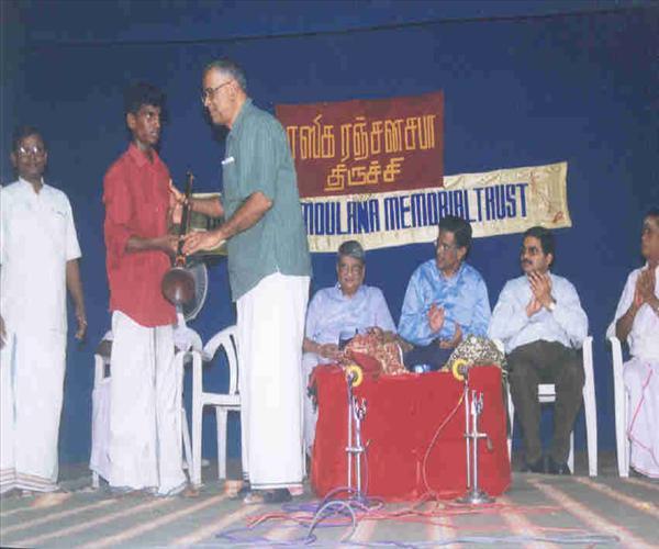 Poor Students Receiving Instruments-03